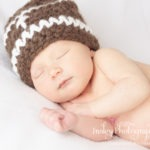 color newborn boy in football knit hat