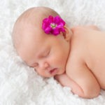 newborn girl with real pink flower