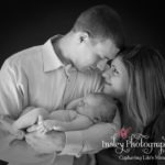Newborn Portraits black & white family cuddling baby girl