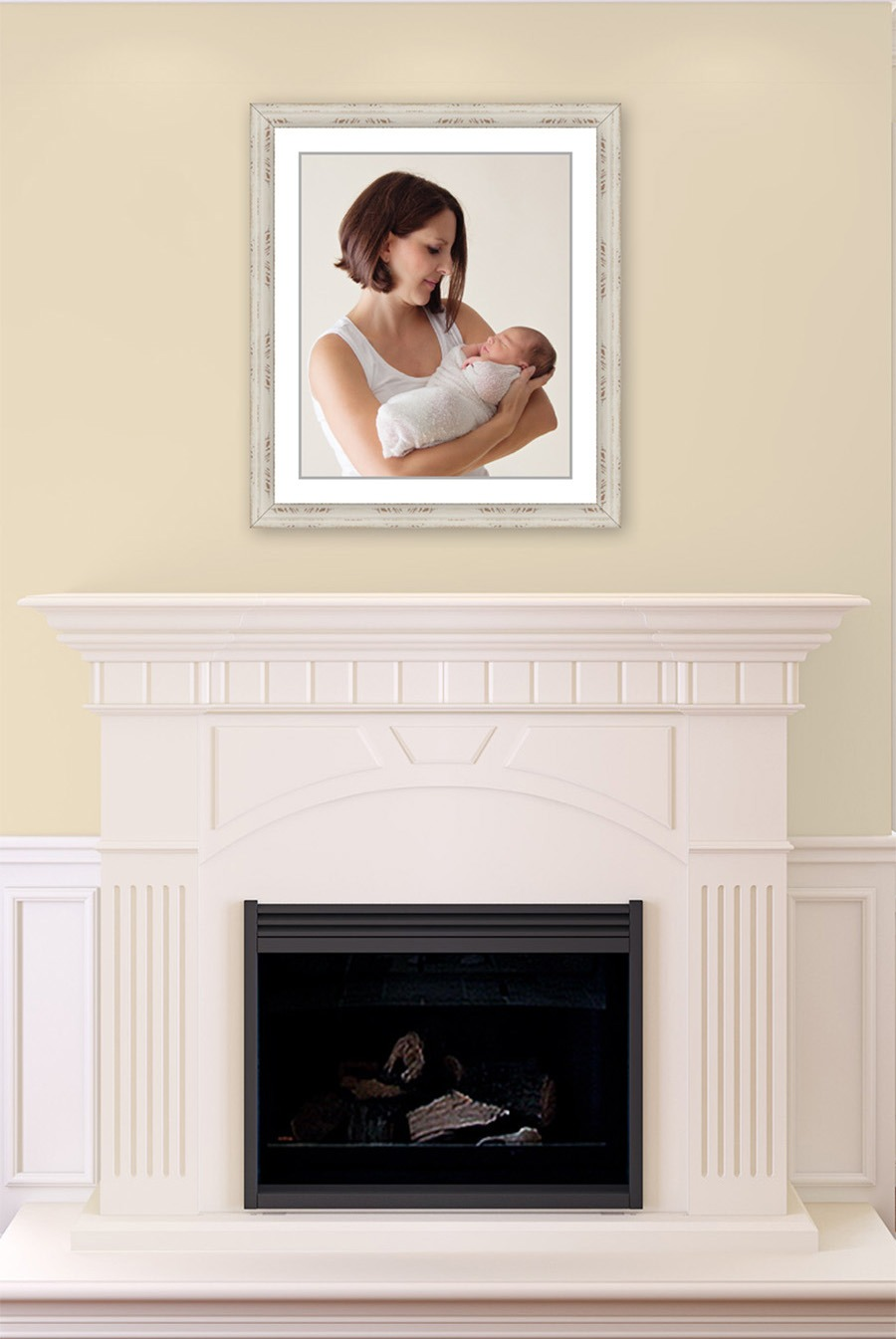 mom and swaddled baby color light high key framed wall portrait over fireplace