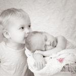 Peyton newborn baby girl sisters sepia