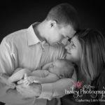 Newborn Portraits black & white family cuddling baby girl