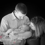 Newborn Portraits family image black and white kissing baby